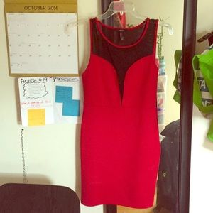 Cute, red mini dress. Screen front and back.